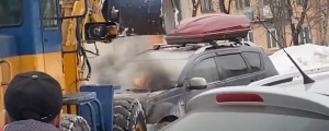 VIDEO: Burning Vehicle Extinguished With Tractor Bucket of Snow